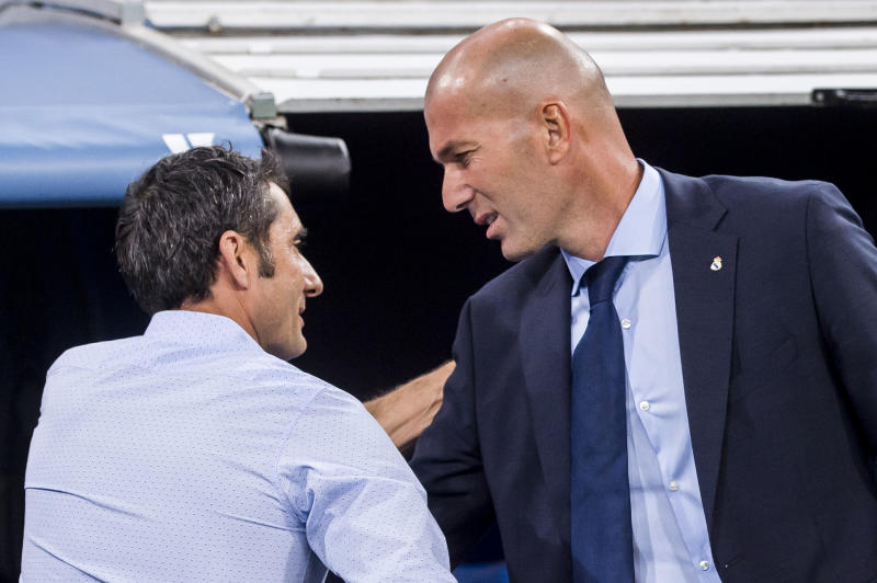Both Barcelona manager Ernesto Valverde (left) and Real Madrid manager Zinedine Zidane wanted El Clasico to be played as scheduled. (Getty)