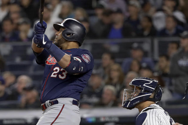 Minnesota Twins designated hitter Nelson Cruz (23) connects for a solo home run against the New York Yankees during the third inning of Game 1 of an American League Division Series baseball game, Friday, Oct. 4, 2019, in New York. (AP Photo/Frank Franklin II)