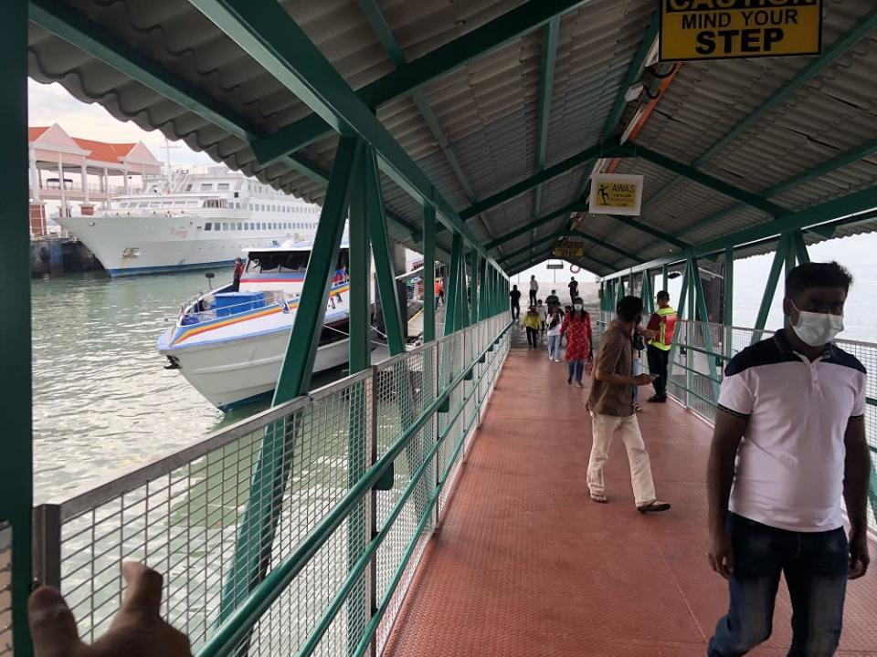 Passengers alighting from the fast boat at Swettenham Pier Cruise Terminal in George Town January 1, 2020.