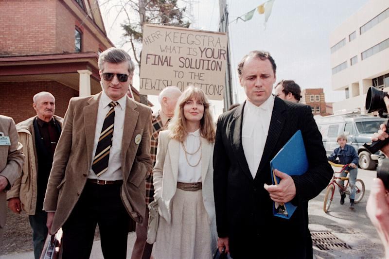 Former Eckville, Alberta teacher Jim Keegstra (left) leaves the Red Deer courthouse on April 9, 1985 with his lawyer Doug Christie and a legal assistant. (Photo: The Canadian Press)