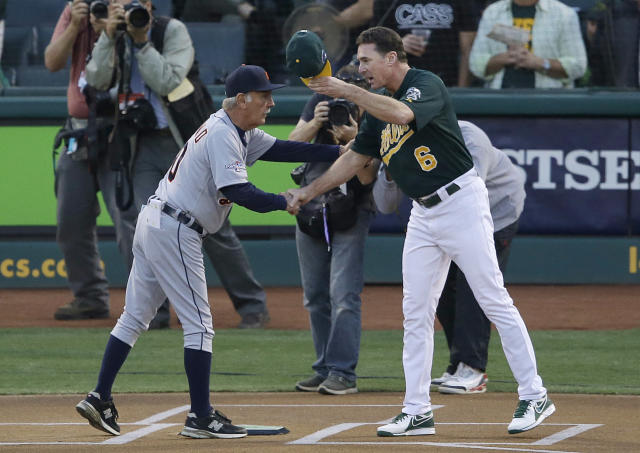 Detroit Tigers manager Jim Leyland, left, shakes hands with Oakland Athletics manager Bob Melvin before Game 1 of the American League baseball division series in Oakland, Calif., Friday, Oct. 4, 2013. (AP Photo/Jeff Chiu)