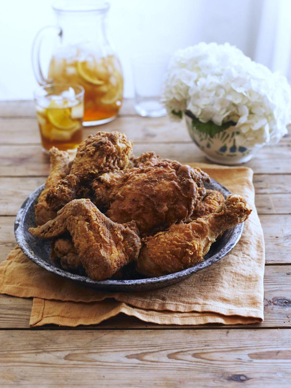 "<p>All good Southern cooks know that a buttermilk marinade, followed by a quick toss in seasoned flour, makes for crisp and tender fried chicken.</p><p><strong><a href=""https://www.countryliving.com/food-drinks/recipes/a1450/spicy-southern-fried-chicken-3566/"" rel=""nofollow noopener"" target=""_blank"" data-ylk=""slk:Get the recipe."" class=""link rapid-noclick-resp"">Get the recipe.</a></strong></p>"