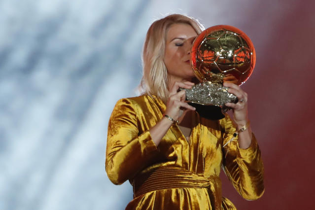 Olympique Lyonnais' Ada Hegerberg celebrates with the Women's Ballon d'Or award during the Golden Ball award ceremony at the Grand Palais in Paris, France, Monday, Dec. 3, 2018. Awarded every year by France Football magazine since Stanley Matthews won it in 1956, the Ballon d'Or, Golden Ball for the best player of the year will be given to both a woman and a man. (AP Photo/Christophe Ena)