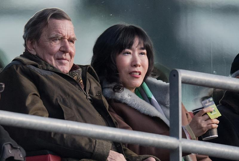 Image result for Schroeder, his new Korean wife, Trump, and Kim