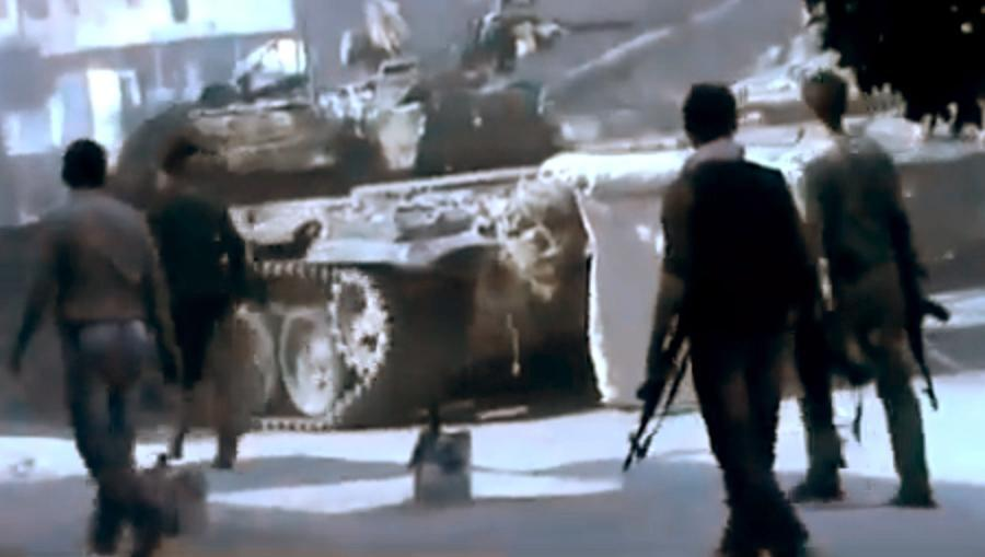 In this image made from amateur video released by the Ugarit News and accessed Monday, July 23, 2012, Free Syrian Army soldiers are seen during clashes with Syrian government troops in Aleppo, Syria. The Syrian regime acknowledged for the first time Monday that it possessed stockpiles of chemical and biological weapons and said it will only use them in case of a foreign attack and never internally against its own citizens. (AP Photo/Ugarit News via AP video) TV OUT, THE ASSOCIATED PRESS CANNOT INDEPENDENTLY VERIFY THE CONTENT, DATE, LOCATION OR AUTHENTICITY OF THIS MATERIAL