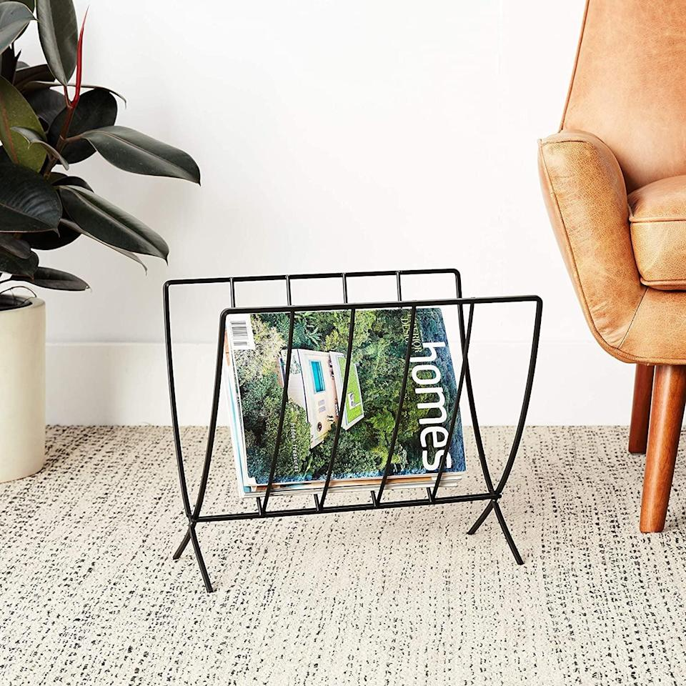 <p>This <span>Spectrum Diversified Seville Rack</span> ($13, originally $23) will store your favorite magazines and newspapers, so you can easily find them.</p>
