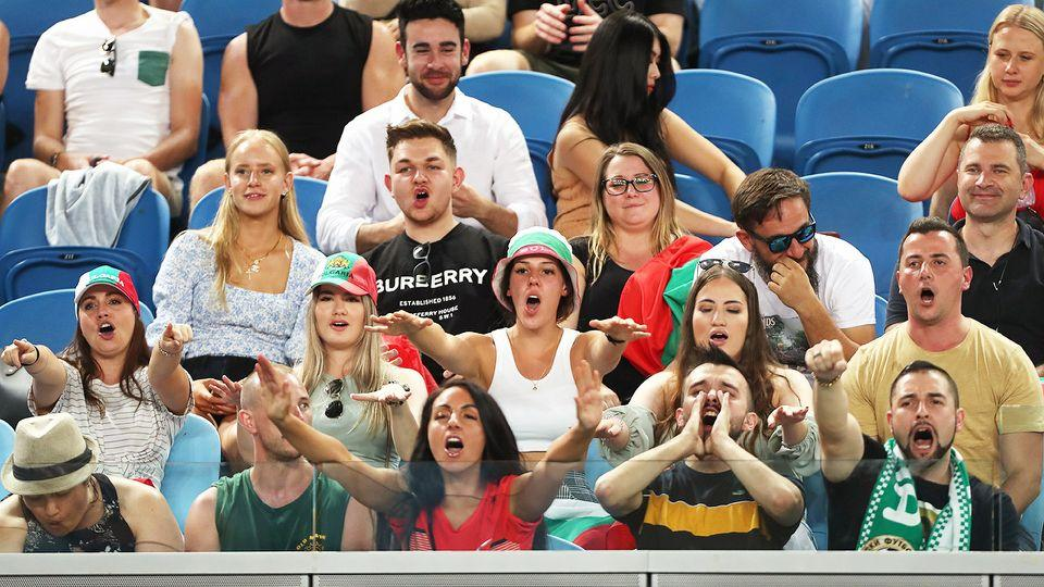 Fans are seen here watching the Australian Open at Melbourne Park on Thursday night.