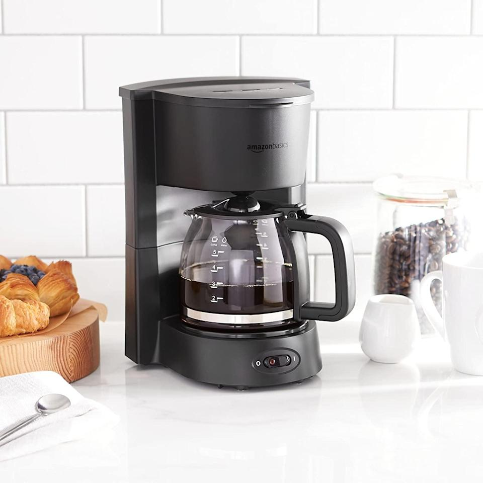 <p><span>AmazonBasics 5-Cup Coffeemaker with Glass Carafe</span> ($12, originally $21)</p>