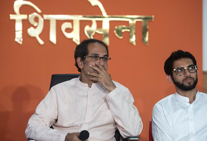 MUMBAI, INDIA NOVEMBER 8: Shiv Sena Chief Uddhav Thackeray and his son Aditya Thackeray during press conference at Sena Bhavan, Dadar, on November 8, 2019 in Mumbai, India. Thackeray launched a scathing attack on the Bharatiya Janata Party (BJP) and accused its top leaders of lying and betraying the Shiv Sena. Uddhav Thackeray said the BJP is not honouring the promise made by BJP president Amit Shah that the two parties will work on a 50:50 formula with rotational chief ministers. (Photo by Satish Bate/Hindustan Times via Getty Images)