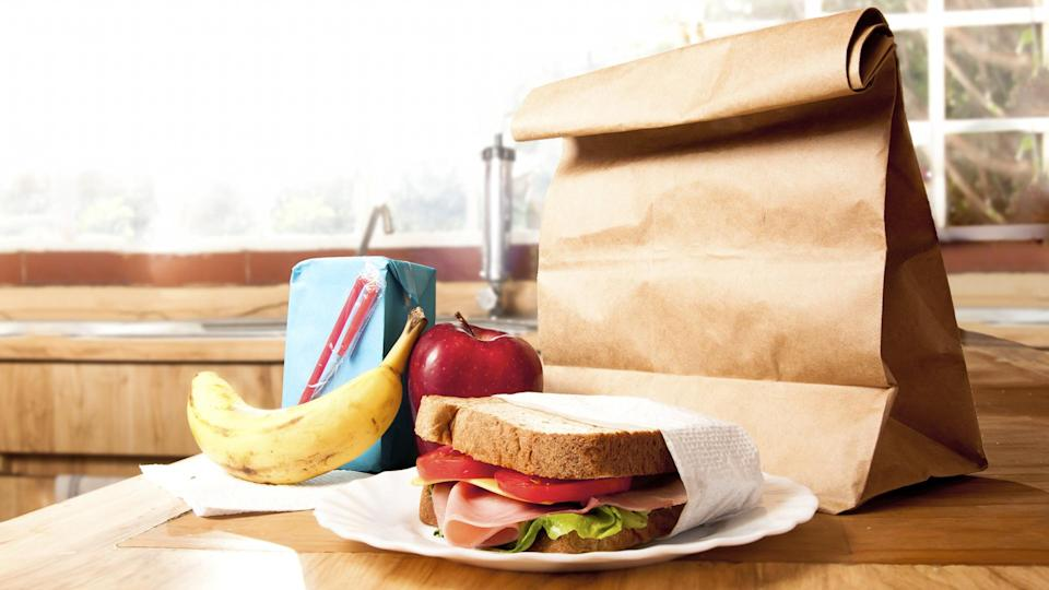 delicious and healthy school lunch with paper bag.