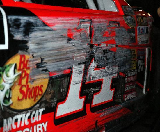 Tony Stewart's damaged car lis shown before being loaded onto a hauler on an NASCAR Sprint Cup auto race at Atlanta Motor Speedway Sunday, Aug. 31, 2014, in Hampton, Ga. (AP Photo/Brynn Anderson)