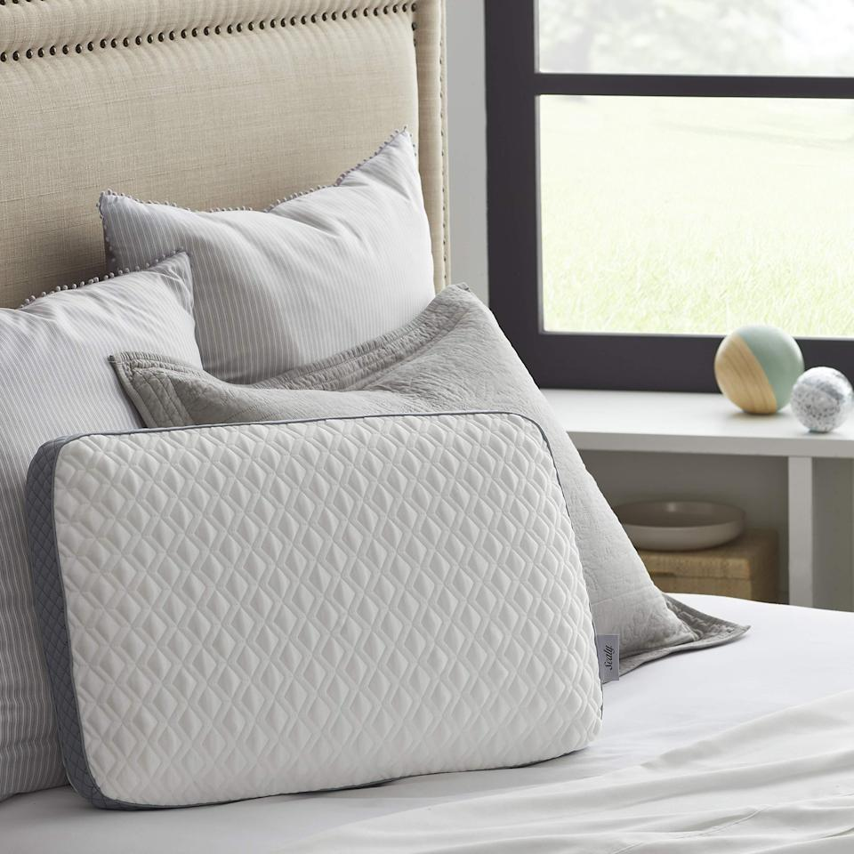 """<h2>Best Affordable Memory Foam Pillow </h2><br><h3>Sealy Molded Memory Foam Pillow</h3><br>The standby mattress brand, <a href=""""http://cocoonbysealy.com"""" rel=""""nofollow noopener"""" target=""""_blank"""" data-ylk=""""slk:Sealy"""" class=""""link rapid-noclick-resp"""">Sealy</a>, is here to bring you a high-quality memory foam pillow at a low cost. Reviewers love it for its removable pillowcase, classy stitching, and body-conforming foam.<br><br><strong>The Hype:</strong> 4.5 out of 5 stars and 4,895 ratings on <a href=""""https://amzn.to/3nynNJK"""" rel=""""nofollow noopener"""" target=""""_blank"""" data-ylk=""""slk:Amazon"""" class=""""link rapid-noclick-resp"""">Amazon</a><br><br><strong>Sound Sleepers say</strong>: """"Very comfy. Good quality memory foam. This comes with a zip-on pillowcase, as seen in the picture, which seems well-made and sturdy. The pillowcase is also very comfy and soft. The cross-stitching feels nice. The pillowcase is breathable and does not get hot. """"<br><br><em>Shop <strong><a href=""""https://amzn.to/3tGb6gZ"""" rel=""""nofollow noopener"""" target=""""_blank"""" data-ylk=""""slk:Amazon"""" class=""""link rapid-noclick-resp"""">Amazon</a></strong></em><br><br><strong>Sealy</strong> Molded Memory Foam Pillow, $, available at <a href=""""https://amzn.to/2Z0ZzOl"""" rel=""""nofollow noopener"""" target=""""_blank"""" data-ylk=""""slk:Amazon"""" class=""""link rapid-noclick-resp"""">Amazon</a>"""