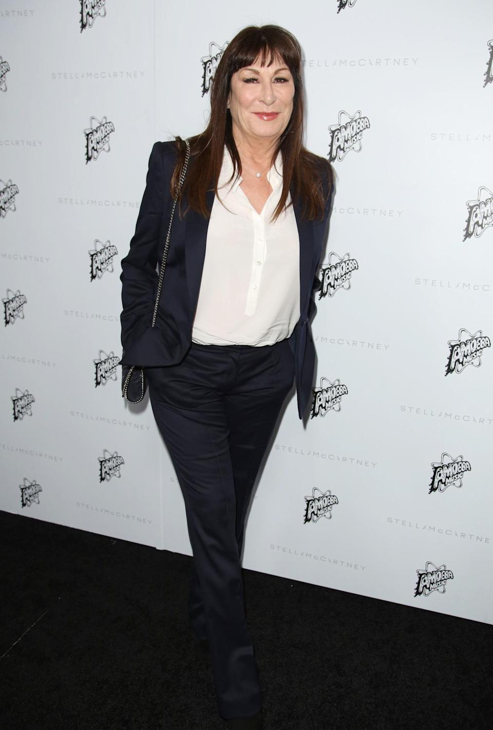 <p>Legendary actress Angelica Huston looked chic in a matching jacket and trouser combo. <i>[Photo: Rex]</i></p>
