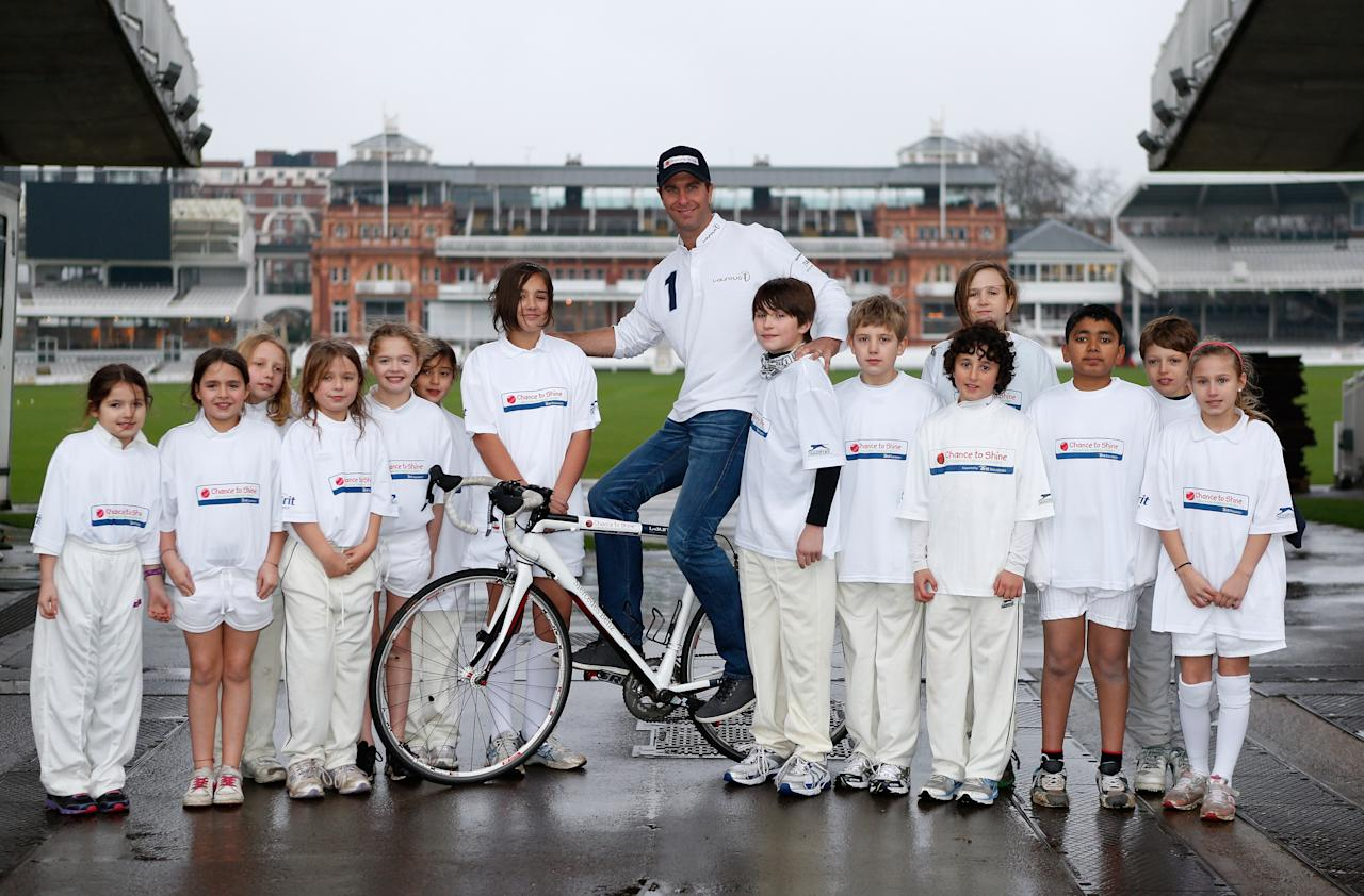 LONDON, ENGLAND - JANUARY 14:  Former England cricket captain Michael Vaughan poses for a picture with children from Chance to Shine to launch the Michael Vaughan Charity Bike Ride to raise funds for the Laureus Sport for Good Foundation and Chance to Shine, on January 14, 2013 in London, England.  (Photo by Tom Shaw/Getty Images for Laureus)