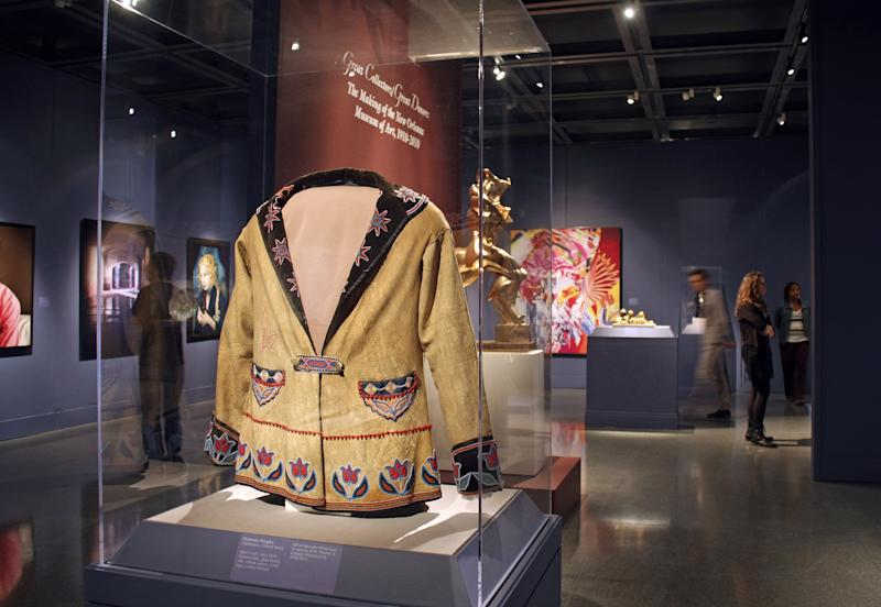 """In this Wednesday, Dec. 1, 2010, image provided by the New Orleans Museum of Art/John d'Addario, a man's jacket made by the Delaware Peoples in Oklahoma is seen on display in """"Great Collectors / Great Donors: The Making of the New Orleans Museum of Art, 1910-2010,"""" an exhibit celebrating the museum's 100th anniversary in New Orleans. NOMA has more than 35,000 pieces in its permanent collection _ ranging from Degas, Picasso, Chagall and other big-name artists, to dramatic African and Asian art, antique glass and a sculpture garden featuring works by 20th century greats such as Henry Moore and Louise Bourgeois.  (AP Photo/New Orleans Museum of Art, John d'Addario)  NO SALES"""
