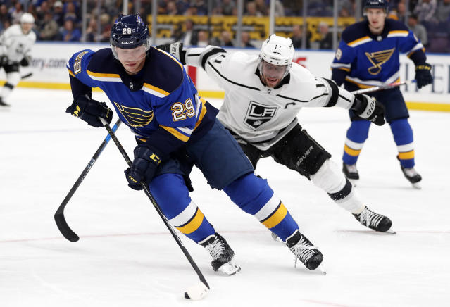 St. Louis Blues' Vince Dunn controls the puck as Los Angeles Kings' Anze Kopitar (11), of Slovenia, watches during the third period of an NHL hockey game Monday, Nov. 19, 2018, in St. Louis. The Kings won 2-0.(AP Photo/Jeff Roberson)