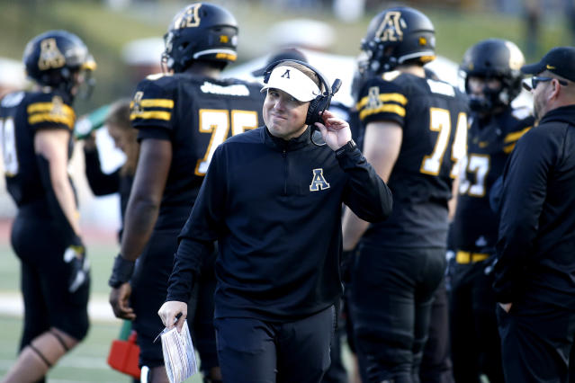 Appalachian State head coach Eliah Drinkwitz makes his way back to the sidelines during the second half of a game on Dec. 7. (AP)