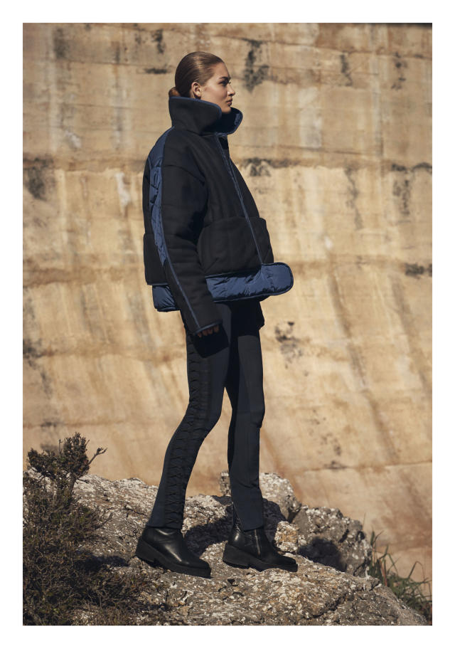 Model Grace Elizabeth in a black-and-navy puffer jacket, cross-stitched pants, and boots from H&M Studio AW17, photographed by Christian MacDonald, styled by Ludivine Poiblanc, in Mallorca, Spain. (Photo: Courtesy of H&M)