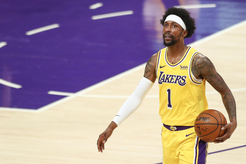 LOS ANGELES, CALIFORNIA - FEBRUARY 20: Kentavious Caldwell-Pope #1 of the Los Angeles Lakers looks on during the game against the Miami Heat at Staples Center on February 20, 2021 in Los Angeles, California. NOTE TO USER: User expressly acknowledges and agrees that, by downloading and or using this photograph, User is consenting to the terms and conditions of the Getty Images License Agreement. (Photo by Meg Oliphant/Getty Images)