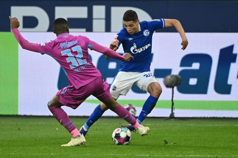 Moroccan international Amine Harit (R) of Schalke contests possession against Hoffenheim in the Bundesliga at the weekend.
