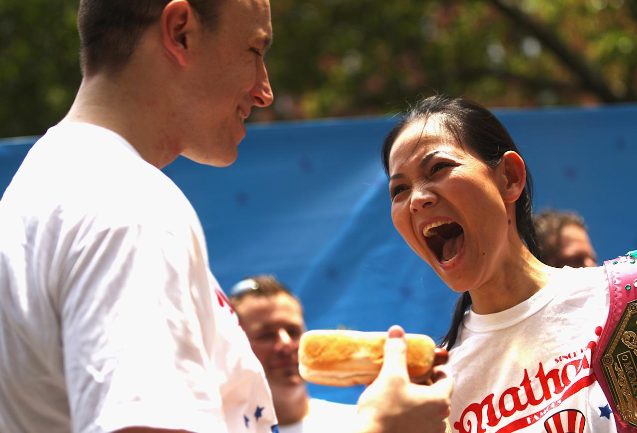 Five-time hot dog eating world champion Joey Chesnut (L) and women's world record holder Sonya Thomas laugh during the Nathan's Famous Fourth of July International Hot Dog Eating Contest weigh-in ceremony on July 3, 2012 in New York City.  The annual hot odg eating event is expected to draw 30,000 fans on July 4, in Coney Island section of Brooklyn. (Photo by Mario Tama/Getty Images)