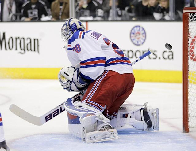 Los Angeles Kings defenseman Drew Doughty scores past New York Rangers goalie Henrik Lundqvist, of Sweden, during the second period of Game 1 in the NHL Stanley Cup Final hockey series on Wednesday, June 4, 2014, in Los Angeles.(AP Photo/Jae C. Hong)