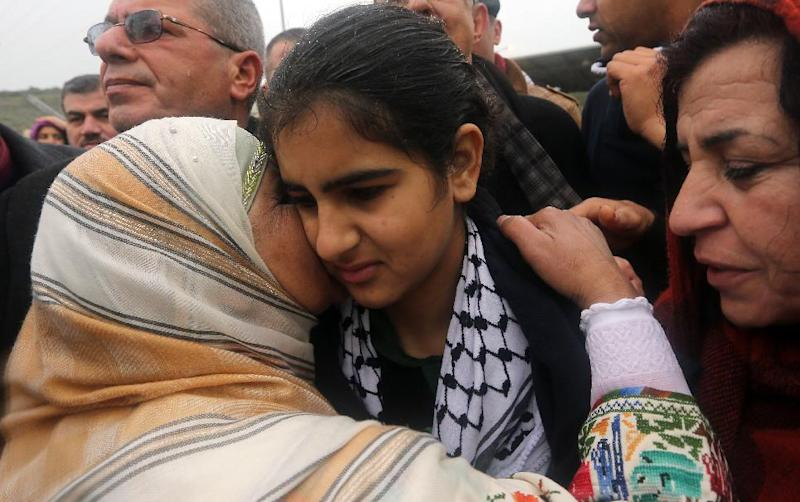 Palestinian 14-year-old schoolgirl Malak al-Khatib is greeted by relatives after her release from an Israeli jail on February 13, 2015, in the West Bank Palestinian village of Tulkarem