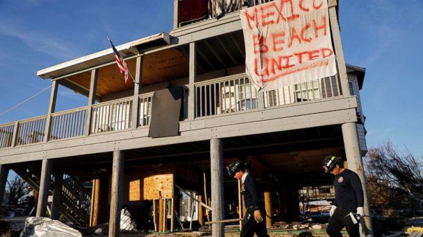 PHOTO: A banner hangs from a damaged home as a South Florida urban search and rescue team checks for survivors of hurricane Michael in Mexico Beach, Fla., Friday, Oct. 12, 2018. (AP)