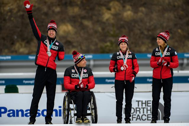 Mark Arendz of Canada and his teammates Chris Klebl, Natalie Wilkie and Emily Young pose with their silver medals on the podium of the Cross Country Skiing 4x2.5km Mixed Relay at the Alpensia Biathlon Centre. The Paralympic Winter Games, PyeongChang, South Korea, Sunday 18th March 2018. OIS/IOC/Thomas Lovelock/Handout via Reuters