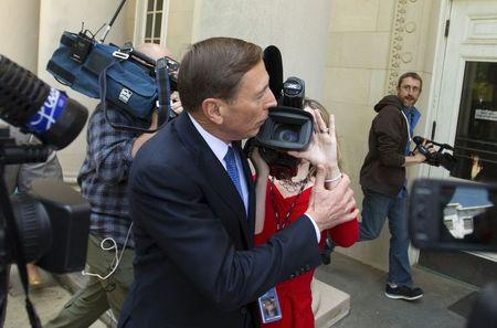 Former CIA director David Petraeus pushes aside a television videographer as he arrives at the Federal Courthouse in Charlotte, North Carolina April 23, 2015. REUTERS/Chris Keane