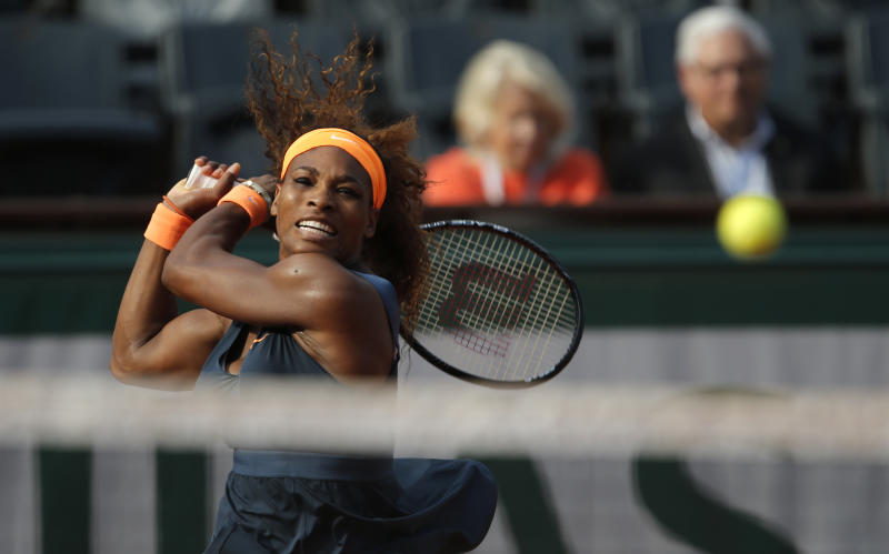 Serena Williams, of the U.S, retusn the ball to Italy's Sara Errani during their semifinal match of the French Open tennis tournament at the Roland Garros stadium Thursday, June 6, 2013 in Paris. (AP Photo/Christophe Ena)