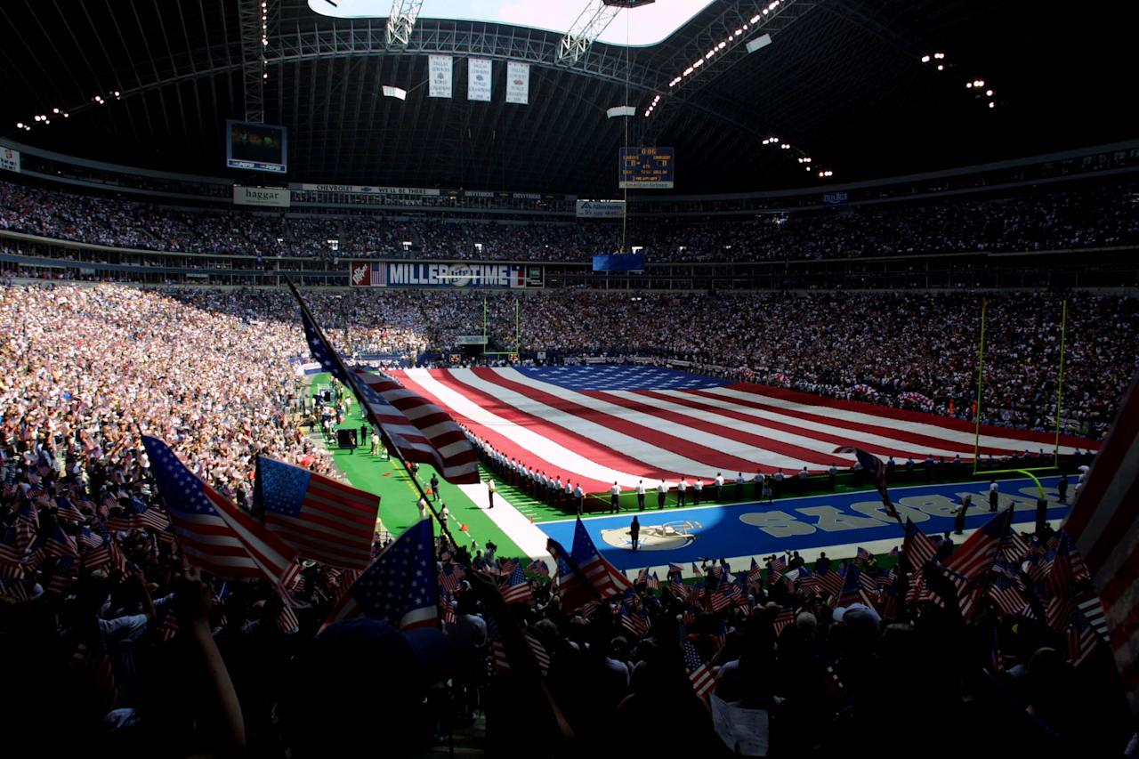 A huge American flag stretches across the field before a game between the San Diego Chargers and Dallas Cowboys at Texas Stadium in Irving, Texas. Chargers defeat the Cowboys 32-21. DIGITAL IMAGE. Mandatory Credit: Ronald Martinez/ALLSPORT