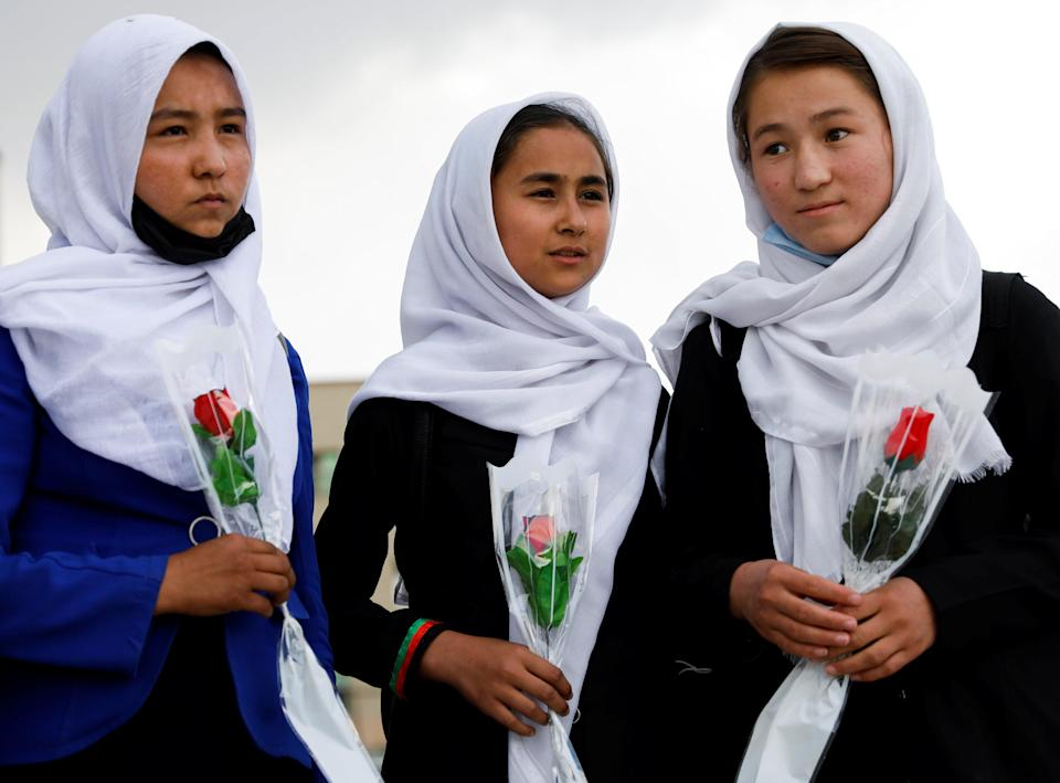 Schoolgirls arrive at a hospital in Kabul to visit students who were injured in a car bomb blast on SaturdayReuters