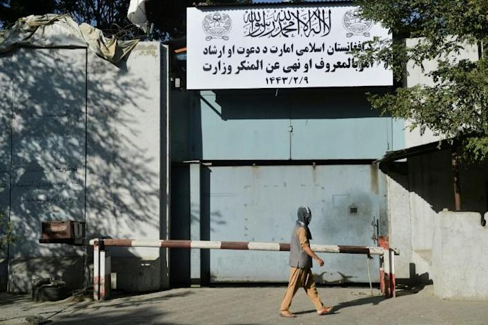 Workers put up a sign for the notorious Ministry for the Promotion of Virtue and Prevention of Vice at the old Women's Affairs building in Kabul (AFP/Hoshang Hashimi)