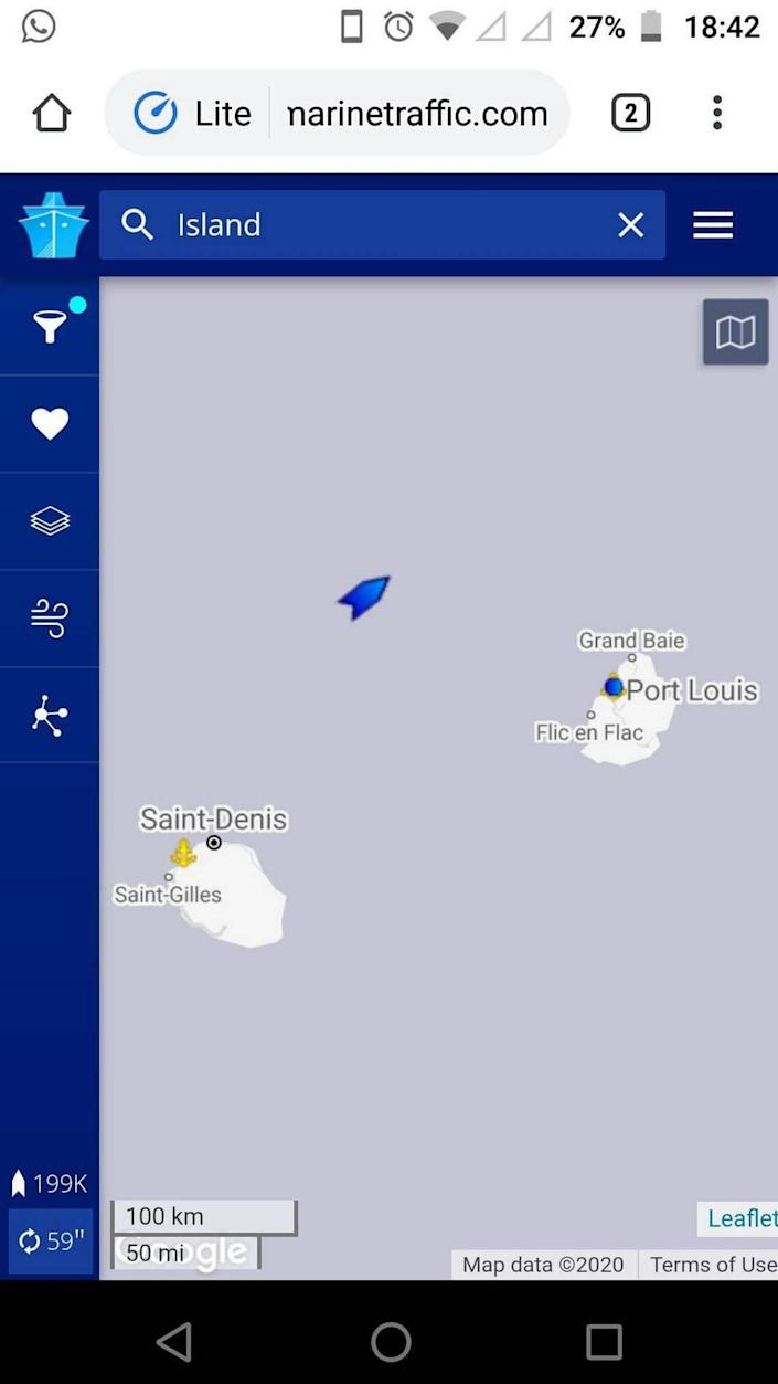 Gan Sungaralingum's phone screen shows the location of the Island Princess as it passes within 50 miles of his homeland of Mauritius and the capitol Port Louis May 25, 2020. Mauritius was locked down due to the pandemic and would not let any ships into port to let the crew members come home. Gan was stuck at sea for three more months after passing his homeland.