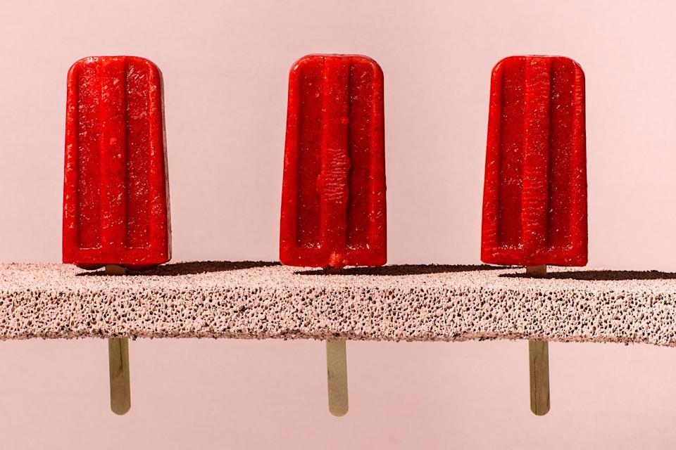 """Using frozen strawberries ensures a consistent sweetness and vibrant red color. <a href=""""https://www.bonappetit.com/recipe/strawberry-cucumber-ice-pops?mbid=synd_yahoo_rss"""" rel=""""nofollow noopener"""" target=""""_blank"""" data-ylk=""""slk:See recipe."""" class=""""link rapid-noclick-resp"""">See recipe.</a>"""