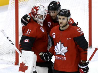 Members of the Canadian team celebrate after their win over hosts South Korea. Reuters
