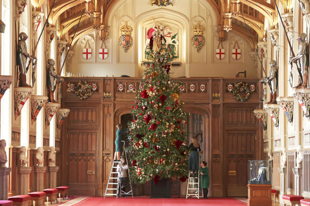 Palace staff decorate the 20ft tree in the castle's St George's Hall [Image: PA Images]