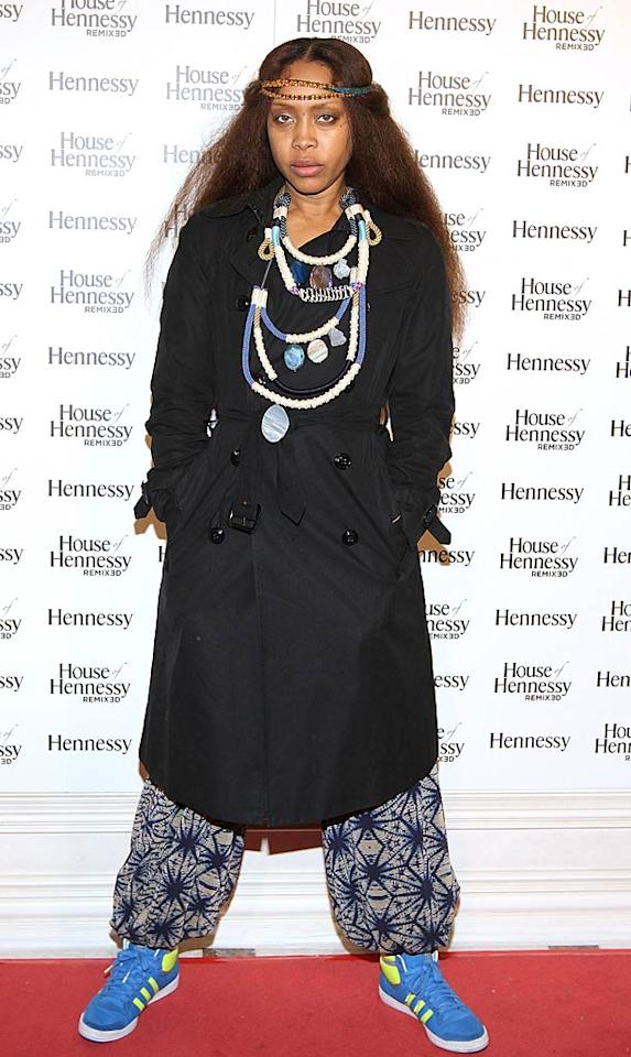 """17. Singer Erykah Badu -- in layered necklaces, a dark trench, MC Hammer pants, and loud sneakers -- at the 5th Annual """"Game Over"""" Party at the House of Hennessy in Dallas, Texas. (02/06/2011)"""