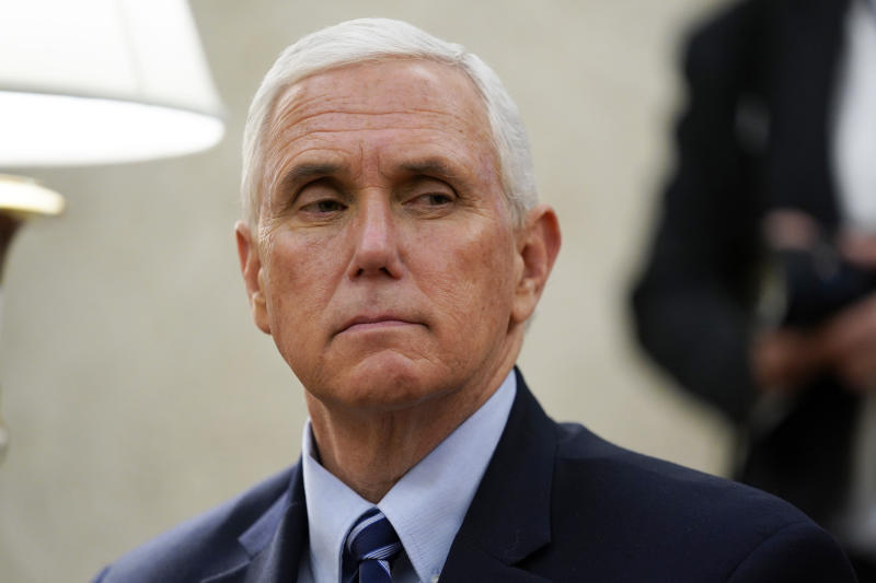 Vice President Mike Pence listens as President Donald Trump holds a meeting about the coronavirus response on Thursday, May 7, 2020, in Washington. (AP Photo/Evan Vucci)