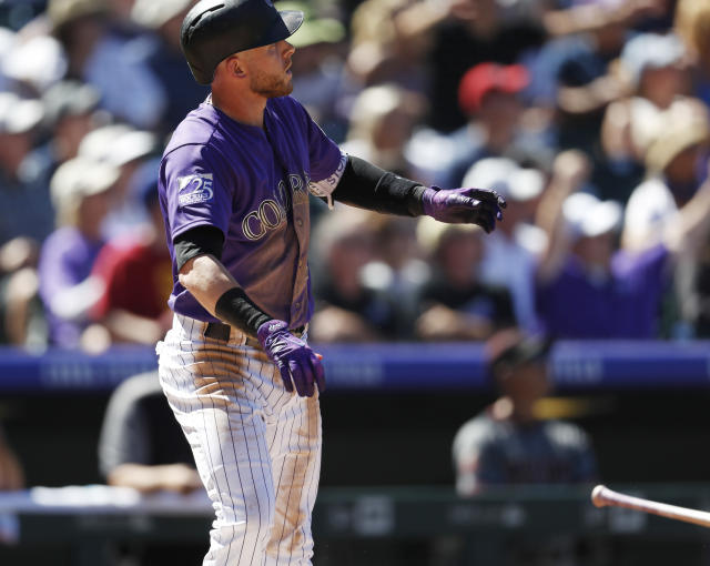 Colorado Rockies' Trevor Story follows the flight of his two-home run off Arizona Diamondbacks starting pitcher Matt Koch in the third inning of a baseball game Thursday, Sept. 13, 2018, in Denver. (AP Photo/David Zalubowski)