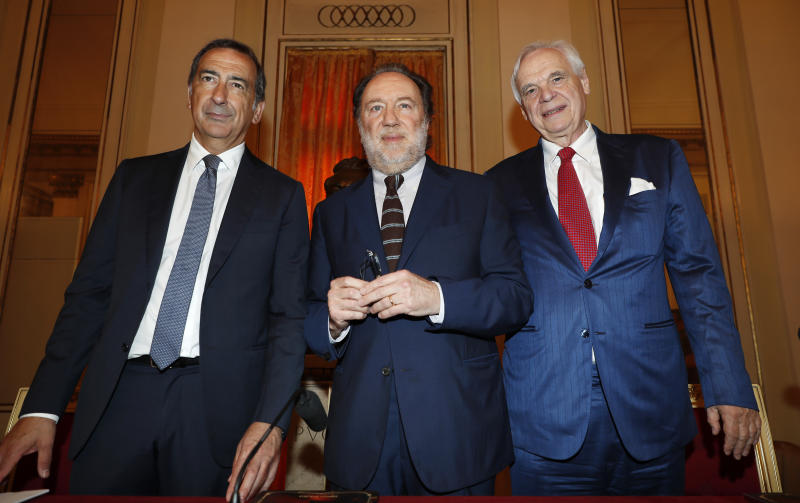 "FILE - In this Wednesday, May 30, 2018 file photo, Milan's mayor Giuseppe Sala, left, Italian conductor Riccardo Chailly, center, and La Scala's general director Alexander Pereira pose for photographers prior to the start of the press conference to present 2018/2019 season, in Milan, Italy. Milan's mayor announced Tuesday that board of the famed La Scala opera house has agreed on a new general manager to succeed Austrian Alexander Pereira, whose money-making but sometimes troubled five-year mandate expires in February. Mayor Giuseppe Sala, who is chairman of the board, declined to identify the candidate due to on-going personnel negotiations, saying only ''I will leave it to your imagination."" Italian media has focused on the manager of the Vienna Staatsoper, Dominique Meyer, after another candidate withdrew. The board will meet next week to confirm. (AP Photo/Antonio Calanni, File)"