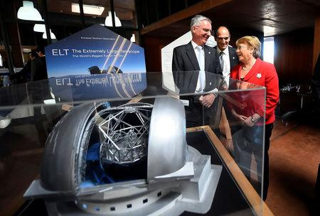 Chile's President Michelle Bachelet and Director General of the European Southern Observatory (ESO) Tim de Zeeuw (L) are seen next to a scale model of the world's largest telescope during a ceremony to inaugurate its construction in the desert of Atacama, Chile, May 26, 2017. Sebastian Rodriguez/Courtesy of Chilean Presidency/Handout via Reuters