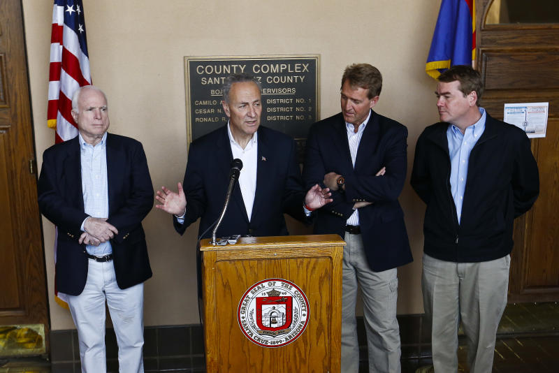 From left, Sen. John McCain, R-Ariz., Sen. Chuck Schumer, D-N.Y., Sen. Jeff Flake, R-Ariz., and Sen. Michael Bennett, D-Colo., address the media during a news conference after their tour of the Mexico border with the United States on Wednesday, March 27, 2013, in Nogales, Ariz.  The senators are part of a larger group of legislators shaping and negotiating details of an immigration reform package vowed Wednesday to make the legislation public when Congress reconvenes next month. (AP Photo/Ross D. Franklin)