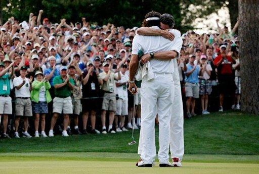 Bubba Watson (R) of the United States hugs his caddie Ted Scott after winning his sudden death playoff