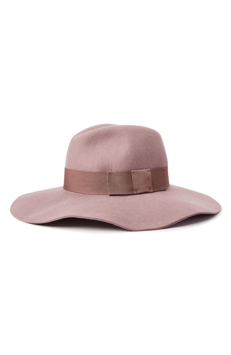 """<p><strong>BRIXTON</strong></p><p>nordstrom.com</p><p><strong>$64.00</strong></p><p><a href=""""https://go.redirectingat.com?id=74968X1596630&url=https%3A%2F%2Fshop.nordstrom.com%2Fs%2Fbrixton-piper-floppy-wool-hat%2F3997472&sref=https%3A%2F%2Fwww.oprahmag.com%2Fstyle%2Fg33275493%2Ffall-hats-for-women%2F"""" rel=""""nofollow noopener"""" target=""""_blank"""" data-ylk=""""slk:Shop Now"""" class=""""link rapid-noclick-resp"""">Shop Now</a></p><p>""""In a romantic shade of mauve, this wide-brim floppy hat is a must for the bohemian aesthetic,"""" says Nazzaro. <br></p>"""