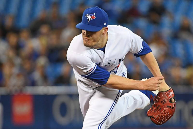 TORONTO, ON - AUGUST 27: Toronto Blue Jays Pitcher Ken Giles (51) pitches in the ninth inning during the game between the Atlanta Braves and Toronto Blue Jays on August 27, 2019 at Rogers Centre in Toronto, ON. (Photo by Gerry Angus/Icon Sportswire via Getty Images)