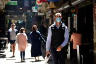 People walk down a city laneway after coronavirus disease restrictions were eased in Melbourne