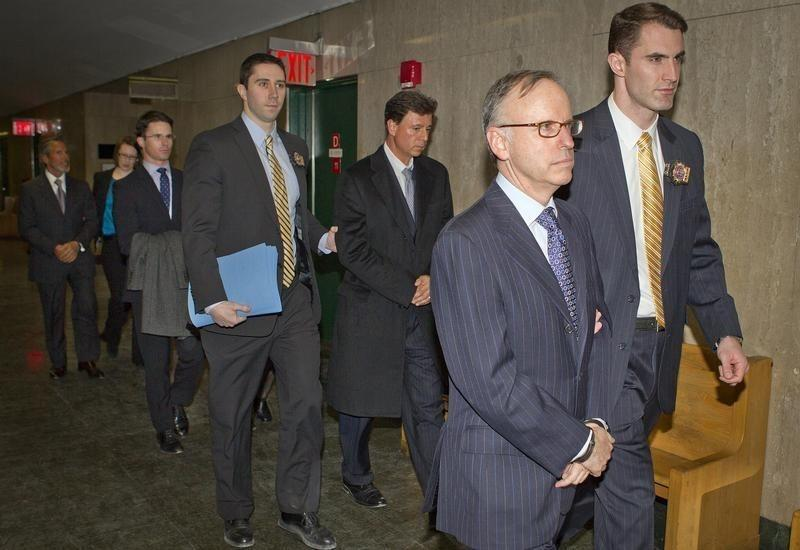 Law firm Dewey and Leboeuf's Davis, Sanders, DiCarmine and Warren arrive in handcuffs to Manhattan Criminal Court in the borough Manhattan borough of New York