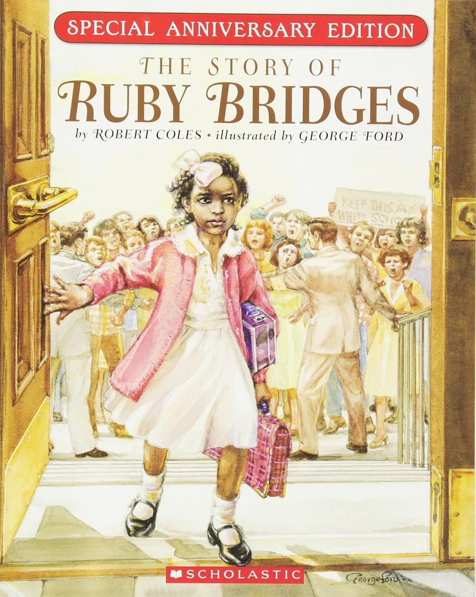"""This book tells the story of <a href=""""https://www.womenshistory.org/education-resources/biographies/ruby-bridges"""" target=""""_blank"""">Ruby Bridges</a>, who became the firstAfrican-American child to integrate a white southern elementary school. (By Robert Coles, illustrated by George Ford)"""